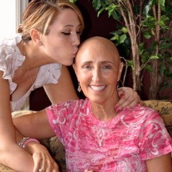 cancer survivor, Kathy Bressler being kissed on the head by her daughter