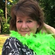 photo of Julie Genovesi in a green boa