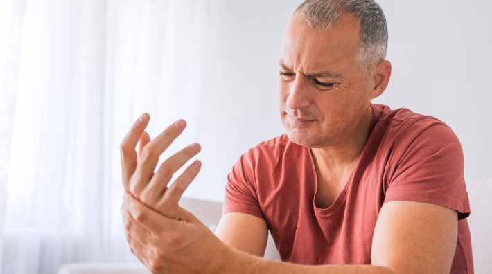 man suffering from hand and wrist pain