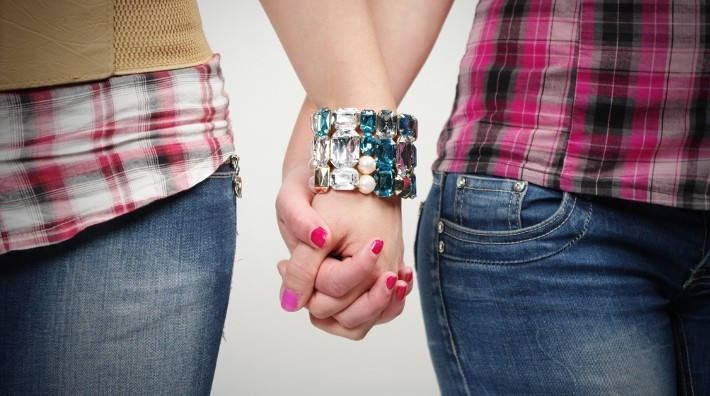 lesbian couple holding hands