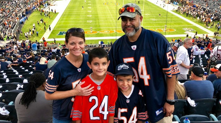 cancer survivor, Roy Arredonda and his family at a football game