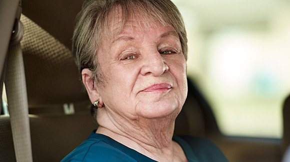 Cancer survivor, Judy, sitting in car